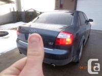 Make Audi Model A4 Year 2003 Colour Dark Grey kms