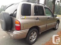 Make Chevrolet Model Tracker Year 2003 Colour Brown