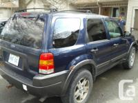 Make Ford Model Escape Year 2003 Colour blue kms