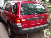 Make Ford Year 2003 Colour red Trans Automatic kms