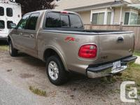 Make Ford Model F-150 Year 2003 Colour Gold Trans