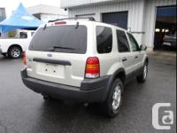 Make Ford Model Escape Year 2003 Colour Tan kms 110481