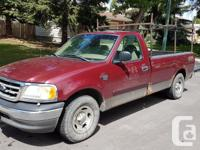 Make Ford Model F-150 Year 2003 Colour Burgandy kms