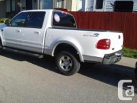 Make Ford Model F-150 SuperCrew Year 2003 Colour white