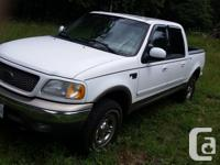Make Ford Year 2003 Colour white Trans Automatic kms