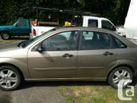 Make Ford Model Focus Year 2003 Colour Brown kms