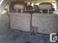 Make GMC Model Envoy XL Year 2003 Colour Medium Brown