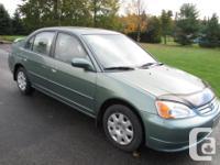 Make Honda Model Civic Year 2003 Colour Green kms
