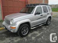 Make Jeep Model Liberty Year 2003 Colour Silver kms