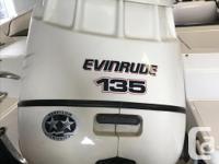 17' Malibu Bowrider with a 135 Evinrude Outboard Motor.