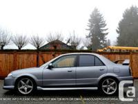 Make Mazda Model Protege Year 2003 Colour Grey kms