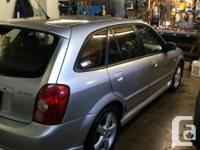 Make Mazda Model Protege5 Year 2003 Colour grey kms