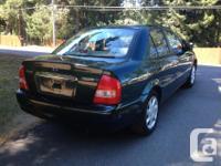 Make Mazda Model Protege Year 2003 Colour Green kms