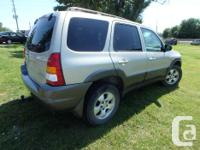 Make Mazda Model Tribute Year 2003 Colour Silver kms