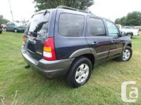 Make Mazda Model Tribute Year 2003 Colour Blue kms