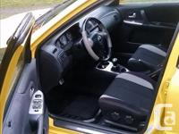 Make Mazda Model Protege Year 2003 Colour Yellow kms