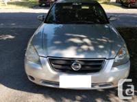 Make Nissan Model Altima Year 2003 Colour Silver kms