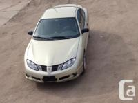 Make Pontiac Model Sunfire Year 2003 Colour Golden
