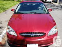 Make Ford Model Taurus Year 2003 Colour Red kms 120000