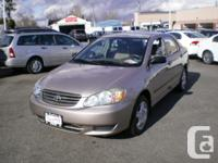 Make Toyota Model Corolla Year 2003 Colour Brown kms