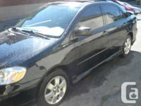 Make Toyota Model Corolla Year 2003 Colour black kms