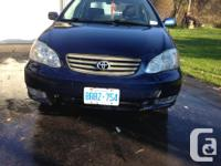 Make Toyota Model Corolla CE Year 2003 Colour Blue kms