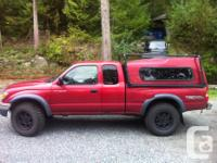 Make Toyota Model Tacoma Year 2003 Colour red kms