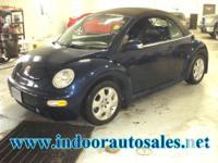 Make. Volkswagen. Model. New Beetle. Year. 2003.