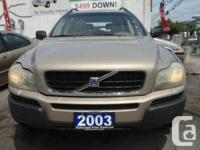 Beige with 6 cylinder automatic transmission, air-con,