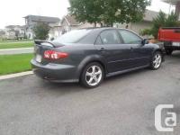 Make. Mazda. Year. 2004. Colour. Grey. kms. 290. 2004