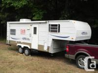 VERY clean and well-kept RV lacks nothing. Roof A/C,