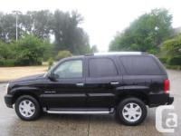 Make Cadillac Model Escalade Year 2004 Colour Black