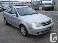 Make Chevrolet Model Optra Year 2004 Colour Silver kms