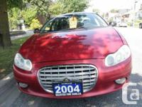 Red with 6 cylinder automatic transmission, air-con,