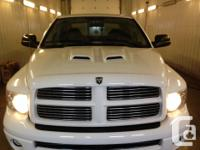 Make Dodge Year 2004 Colour white kms 231000 dodge ram
