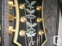 This is an absolutely mint Epiphone Sheraton II made in