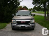 Make GMC Model Sierra Year 2004 Colour Tan kms 230000
