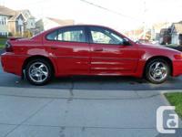 Victory red with dark pewter interior, 3.4L V6 SFI Ram