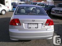 Make Honda Model Civic Si Year 2004 Colour Silver kms