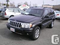 Make Jeep Model Grand Cherokee Year 2004 Colour Black
