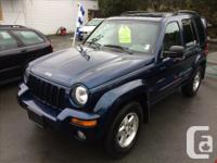 Make Jeep Year 2004 Colour Atlantic Blue Pearl over Tan
