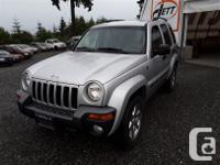 Make Jeep Model Liberty Year 2004 Colour grey kms