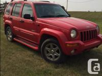 Make Jeep Model Liberty Colour Red Trans Automatic kms