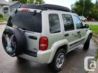 Make Jeep Model Liberty Year 2004 Colour Silver kms