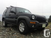 Make Jeep Model Liberty Year 2004 Colour Black kms