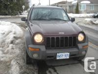 Make Jeep Model Liberty Year 2004 Colour BROWN kms