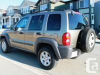Make Jeep Model Liberty Year 2004 Colour Tan kms