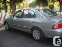 2004 Kia Magentis LX. 4cyl auto loaded.  Top end car in