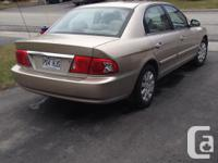 Make Kia Model Mentor Year 2004 Colour Gold kms 113500