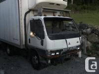 Make Mitsubishi Year 2004 Colour White Trans Automatic